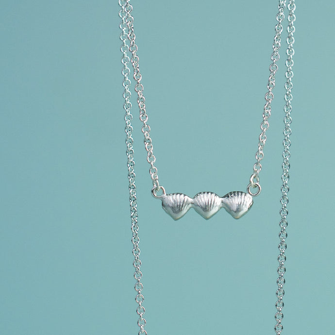 clam bar necklace with three baby clam shells perfect sister gift by hkm jewelry
