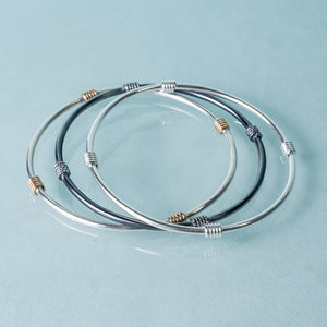 Life saver bangle set by hkm jewelry in silver, and gold
