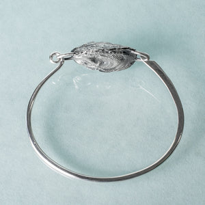 hand forged locking bracelet with cast oyster shell by hkm jewelry