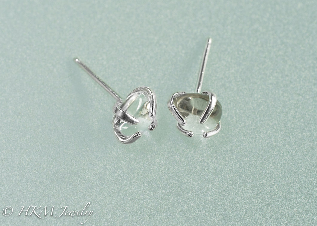 close up side view of small size prong set tumble polished cape may diamond stud earrings in sterling by hkm jewelry
