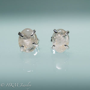 close up of medium size prong set tumble polished cape may diamond stud earrings in sterling by hkm jewelry