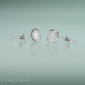 close up side of prong set tumble polished cape may diamond stud earrings in sterling by hkm jewelry