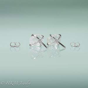 back view of medium size prong set tumble polished cape may diamond stud earrings in sterling with ear nuts by hkm jewelry