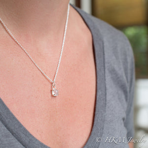 model wearing small prong set tumble polished cape may diamond necklace by HKM Jewelry