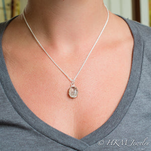 model wearing large prong set tumble polished cape may diamond necklace by HKM Jewelry