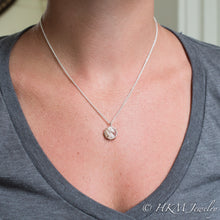 Load image into Gallery viewer, model wearing medium prong set tumble polished cape may diamond necklace by HKM Jewelry