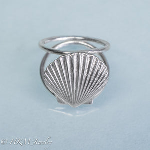close up angled top view of large scallop shell ring on a double band in sterling silver by hkm jewelry