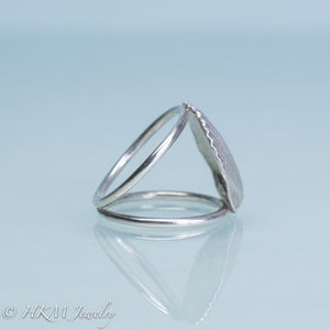 close up side view of large scallop shell ring on a split shank in sterling silver by hkm jewelry