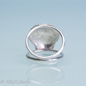 close up underside view of large scallop shell ring on a tapered double band in sterling silver by hkm jewelry