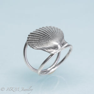 close up angled bottom view of large scallop shell ring on a double band in sterling silver by hkm jewelry