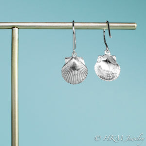 back and front view of the small polished scallop shell dangle earrings in sterling silver by hkm jewelry