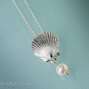 the scallop pearl necklace in polished finish with white freshwater pearl drop by hkm jewelry
