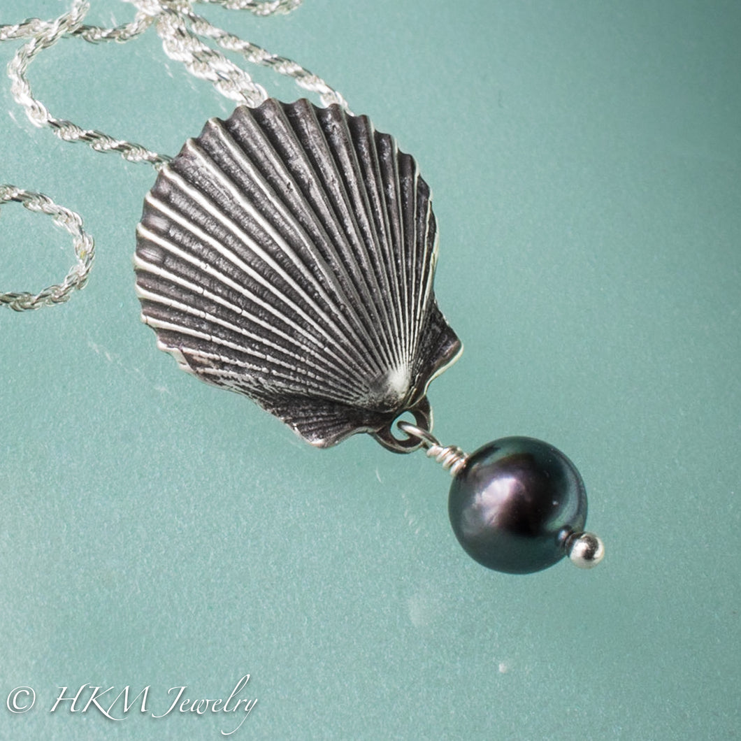 the scallop pearl necklace in oxidized finish with black pearl drop by hkm jewelry