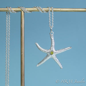 silver starfish necklace with peridot gemstone August birthstone by HKM Jewelry