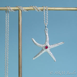 silver starfish necklace with ruby gemstone July birthstone by HKM Jewelry
