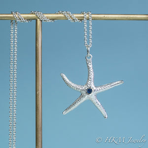 silver starfish necklace with sapphire gemstone September birthstone by HKM Jewelry