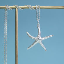 Load image into Gallery viewer, close up view of starfish necklace molded and cast in recycled silver