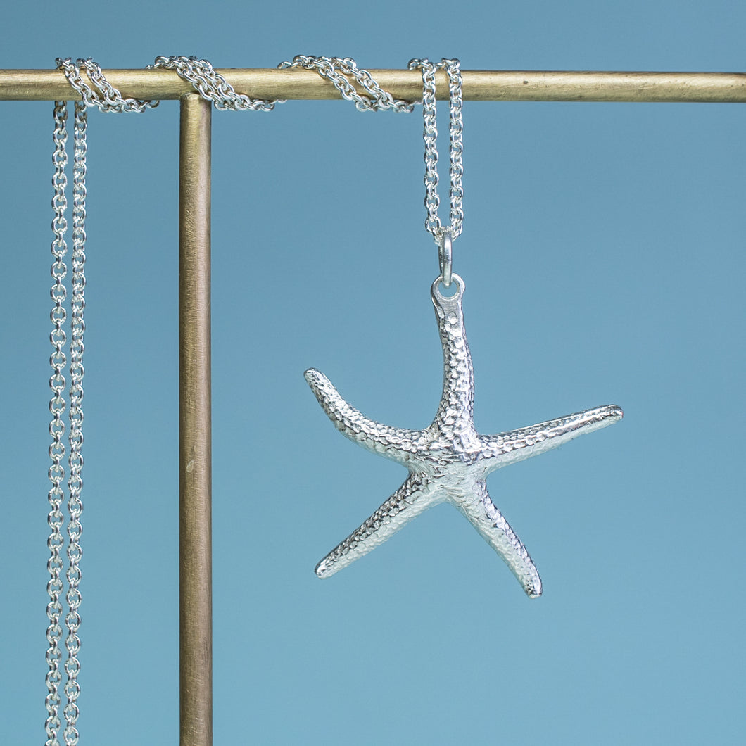 close up view of starfish necklace molded and cast in recycled silver