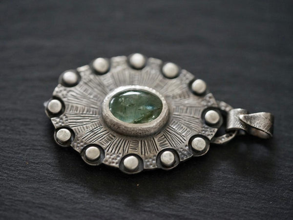 Aquamarine, shield of twelve pendant