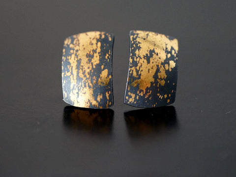 Modern gold on black stud earrings,