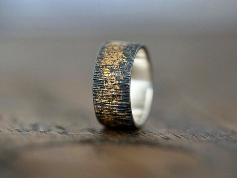 Gold on black wedding band, size 7.25