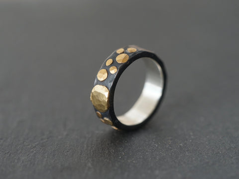 Gold and black ring, size 8