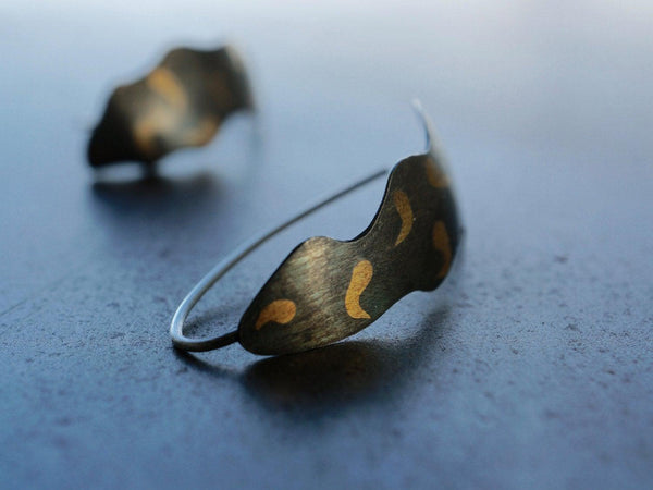Gold on black leaf earrings