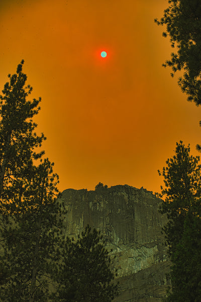 Yosemite National Park during wildfire with orange sky