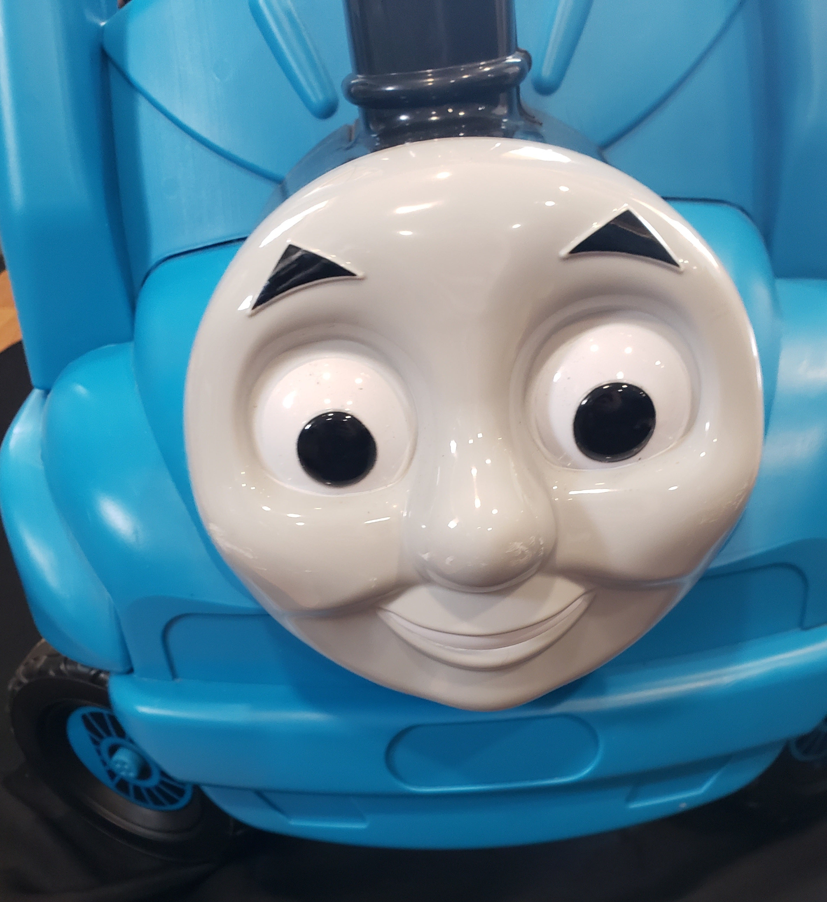 Thomas the Train ridding foot powered car