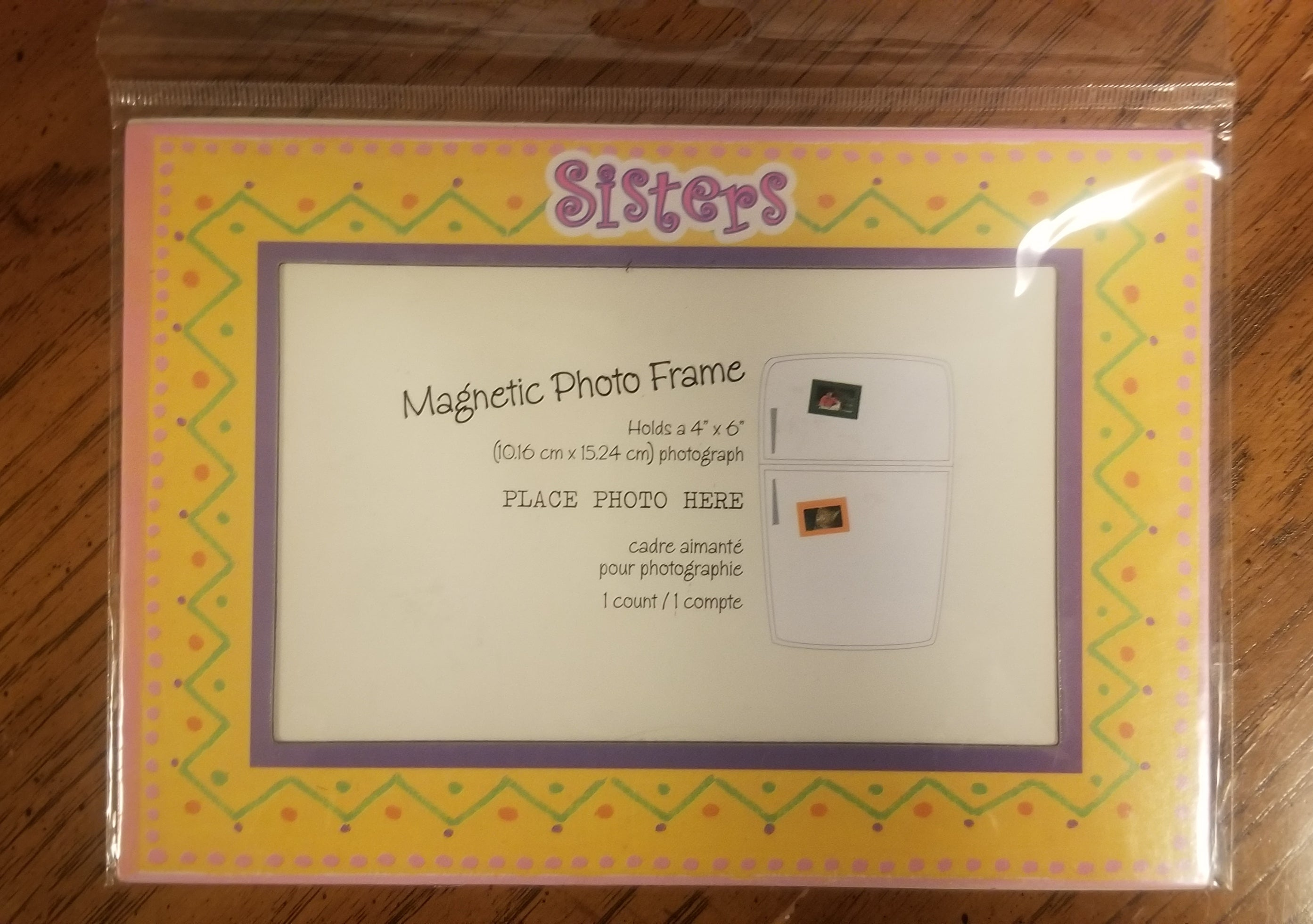"NEW IN PACKAGE magnetic photo frame, yellow ""sisters"""