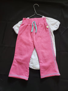 Girls size 24mo 2 piece outfit. Purple onesies with flowers and pink sweat pants