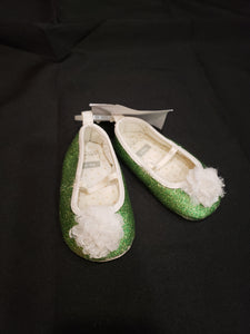 Carter's size 6-9mo green glittery shoes with white flowers (equivilant of size 2)