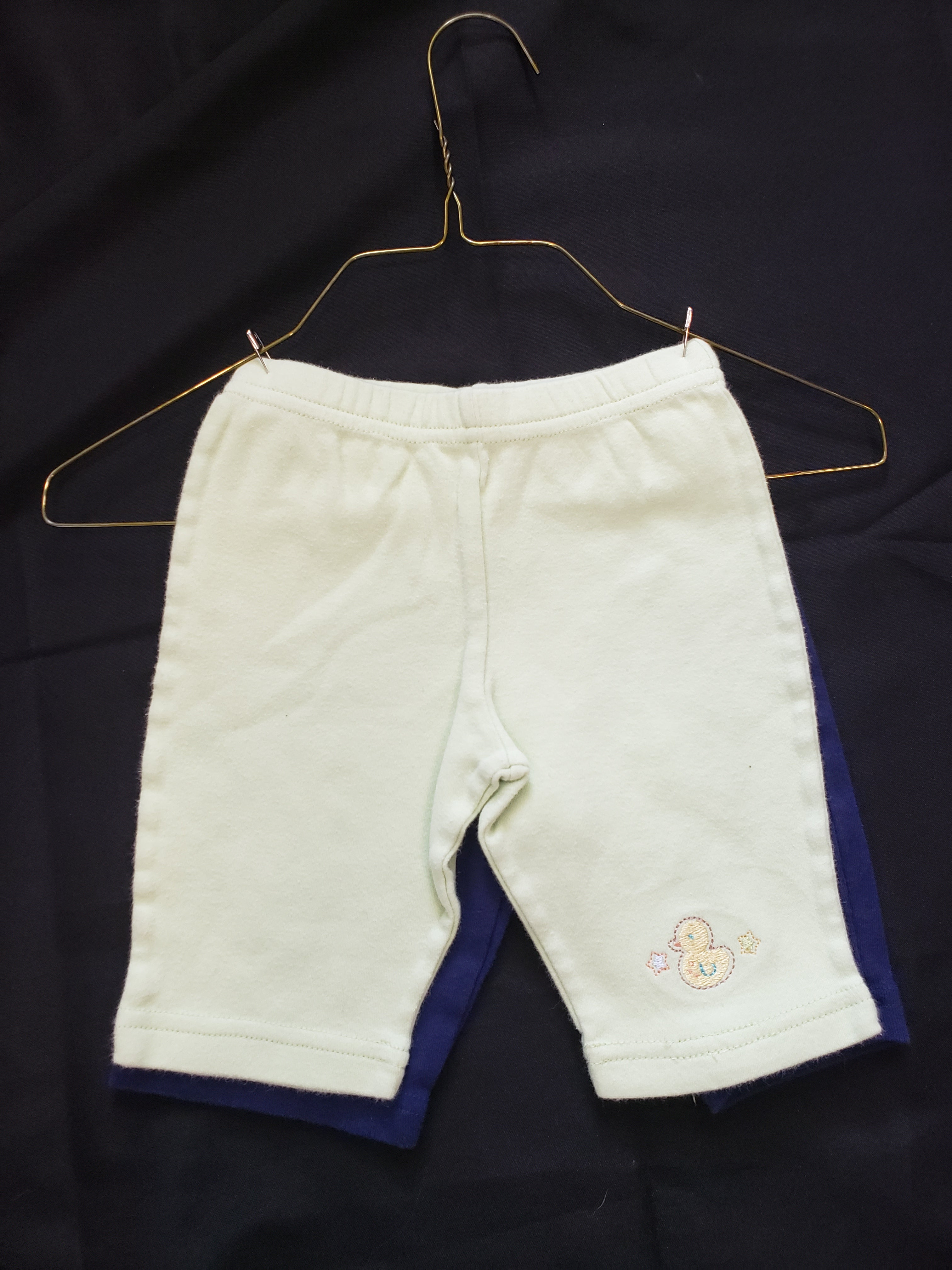 2 pairs of size 0-3mo pants. 1 yellow and 1 blue