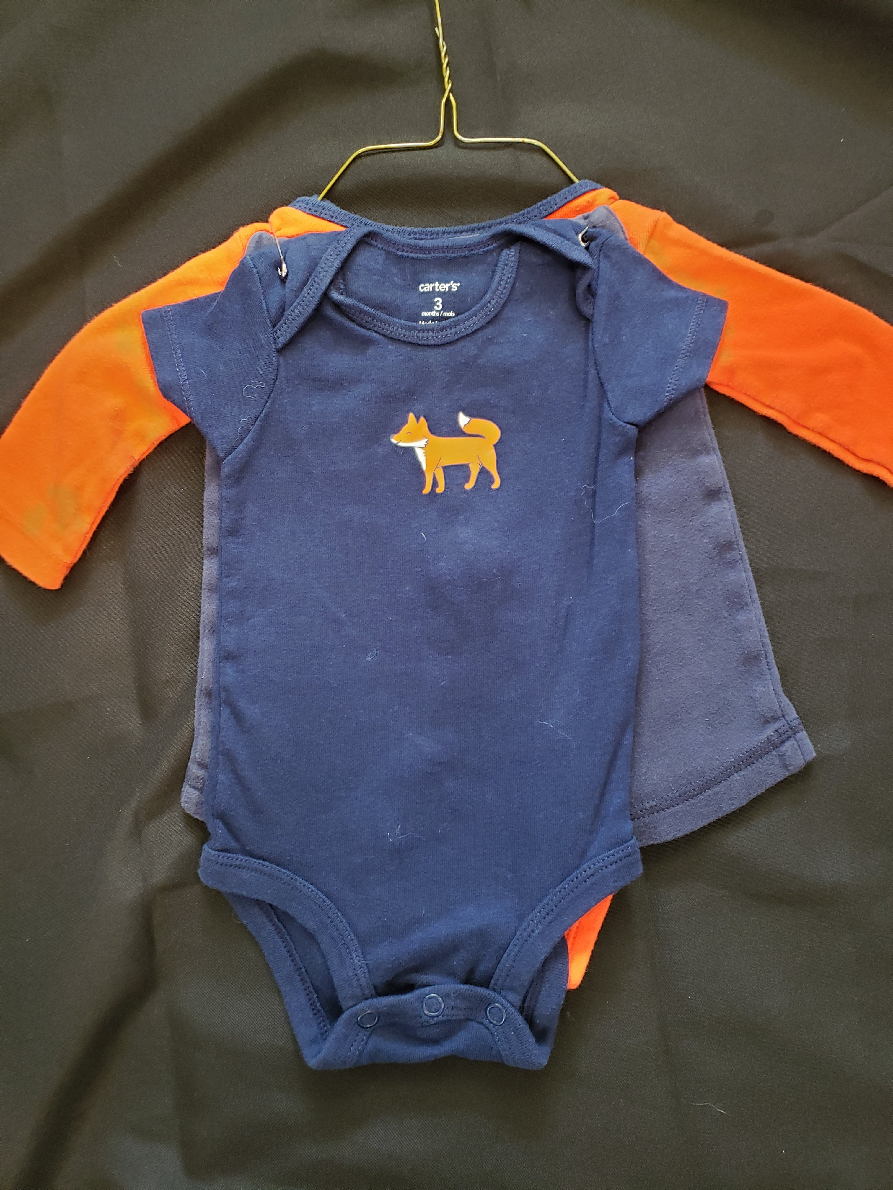 Carter's size 3mo 3 piece outfit. Orange onesie, blue onesie with a fox and blue pants