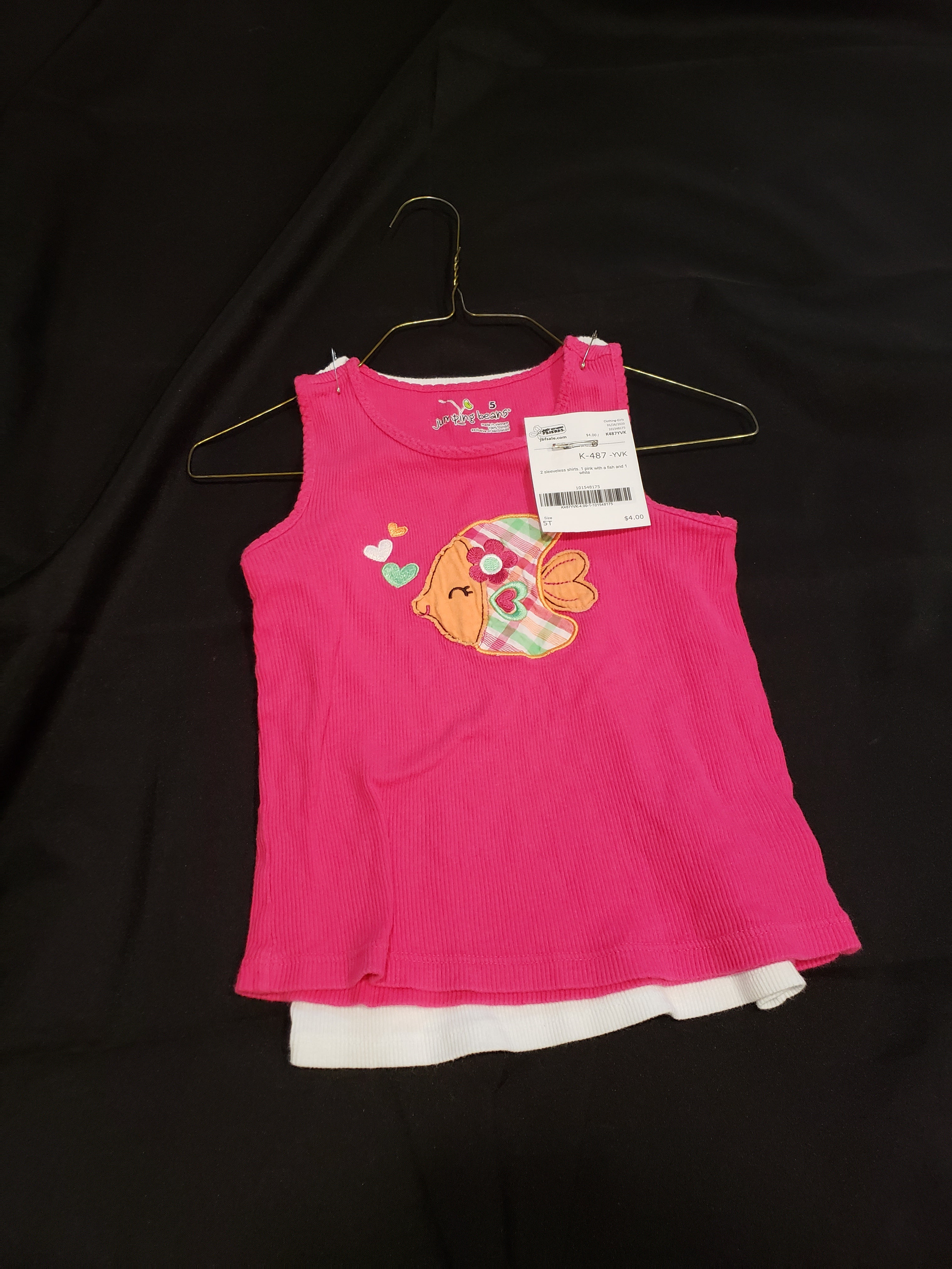 2 size 5T sleeveless shirts. 1 pink with a fish and 1 white