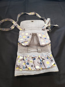 Lilly bit classic diaper clutch. grey with polka dots