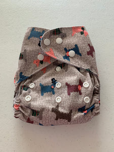 unbranded cloth pocket diaper with bamboo insert. Toupe with scotty dogs print