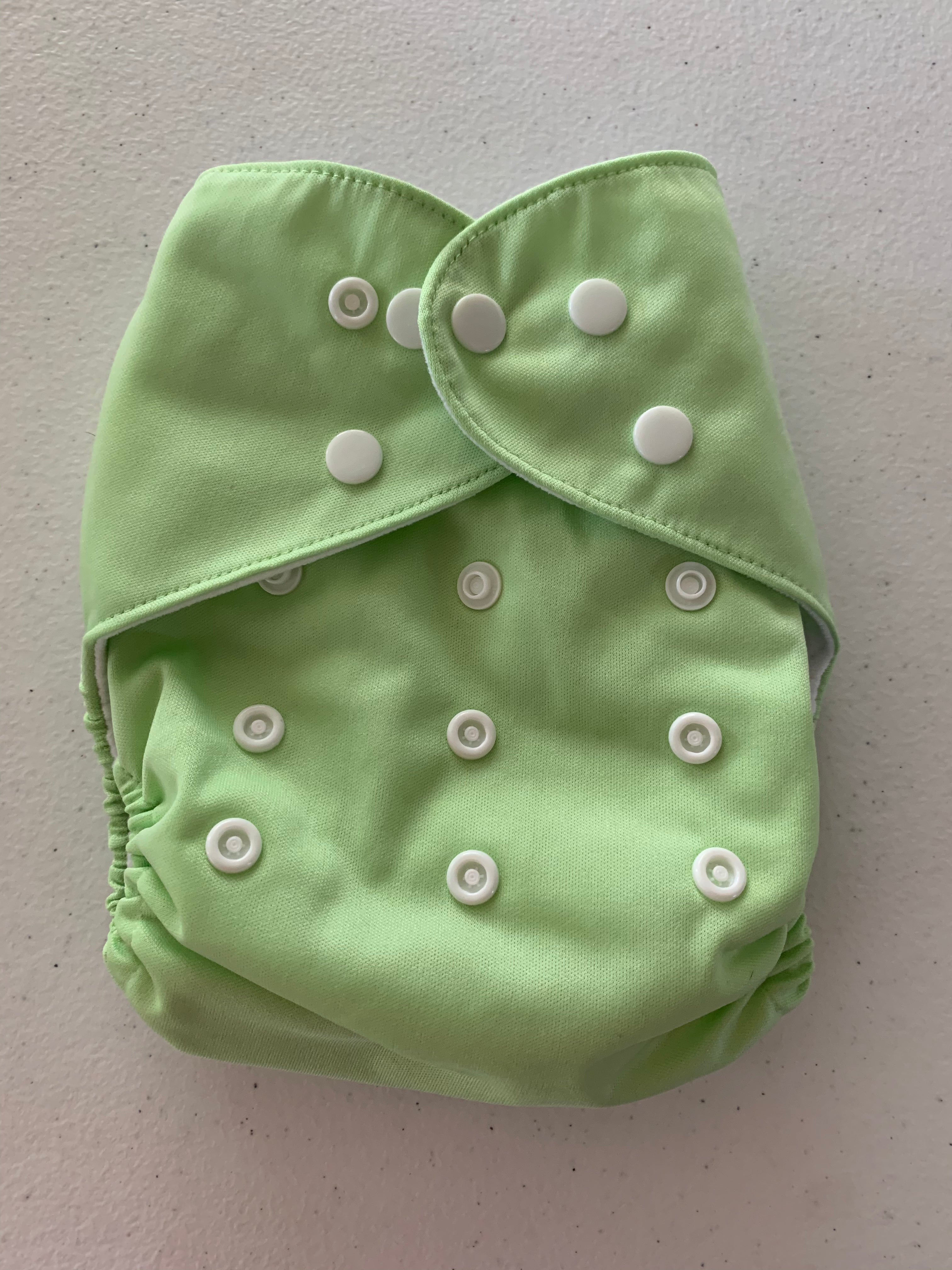 Unbranded cloth pocket diaper with bamboo insert. Lime green