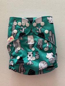 Littles and Bloomz cloth pocket diaper with bamboo insert. Green with black and white cactus's