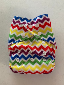 Unbranded cloth pocket diaper with bamboo insert. Rainbow chevron print