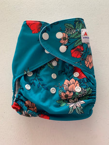 Alva cloth pocket diaper with bamboo insert. Teal with bright pink and pale pink flowers