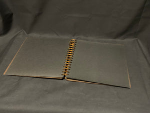 8.5 in x 8.5in spiral bound scrapbook album with 20 black card-stock pages