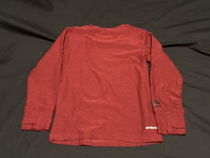 UMBRO red long sleeve athletic shirt with thumb hole. Size 6/7