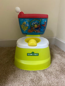 Sesame Street Elmo potty chair; makes flushing sound and Elmo giggles
