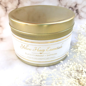 5.5 ounce reusable gold tin with lid wood tube wick coconut wax black currant and saffron clean burning eco luxury candle