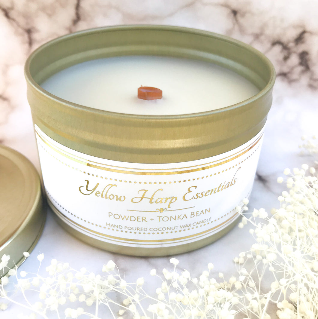 5.5 ounce reusable gold tin with lid wood tube wick coconut wax powder and tonka bean clean burning eco luxury candle