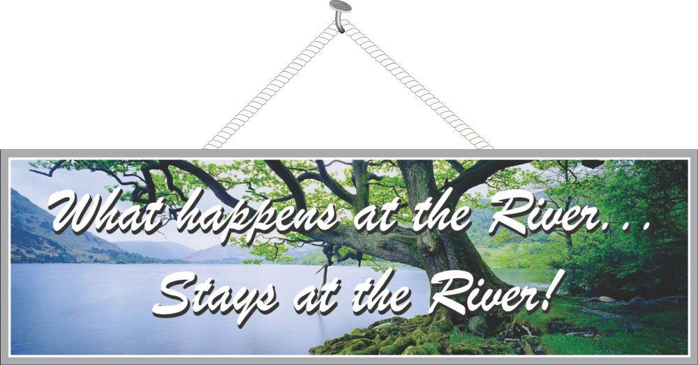 What Happens on the River Stays on the River Sign with Old Tree