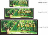 Stag Head Personalized Cabin Welcome Sign with Green Forest Background