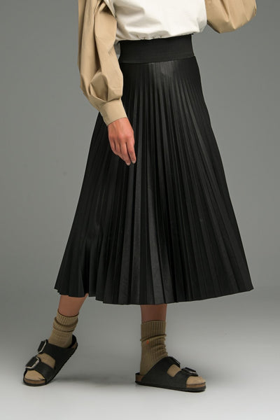 PLEATS PLEASE SKIRT.