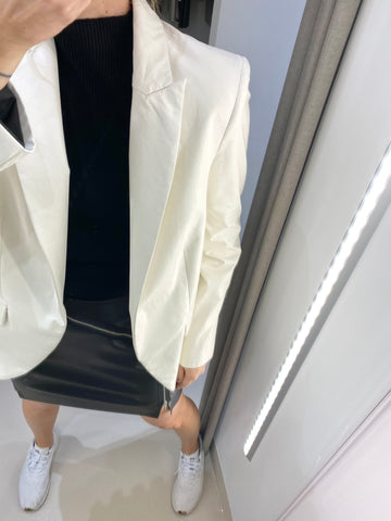 WHITE LEATHER JACKET.